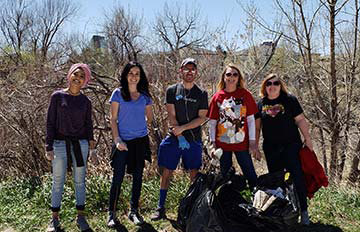 NEHA staff help clean up the environment at Cherry Creek in Glendale, Colorado.