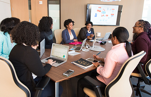 group of women in business attire working together at conference table. Apply Now for the NEHA Health in all Policies (HiAP) Workgroup!
