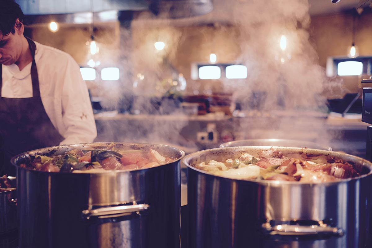 two steaming pots of soup in a restaurant kitchen - Take advantage of our Certified Professional Food Manager with Pro Proctor exam special!