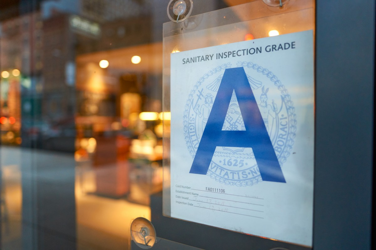 Restaurant inspection score posted in the window.