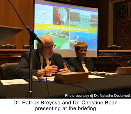Dr. Patrick Breysse and Dr. Christine Bean presenting at the briefing