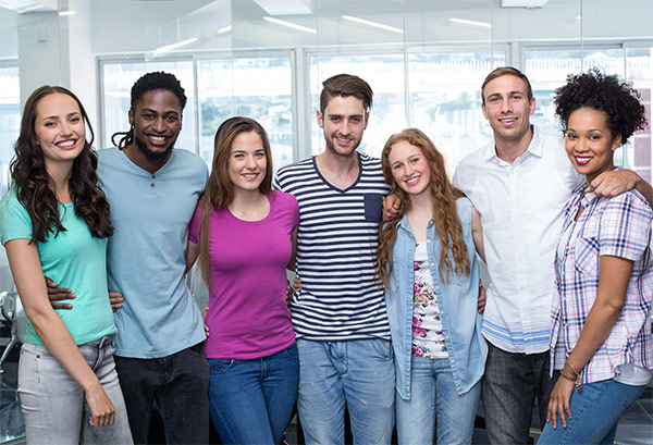 Group of young adults, smiling, standing together