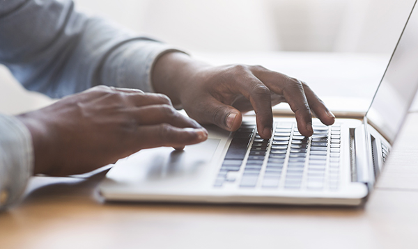 hands typing on a laptop  - Register for the Virtual Inspections During COVID-19 Pandemic Webinar.