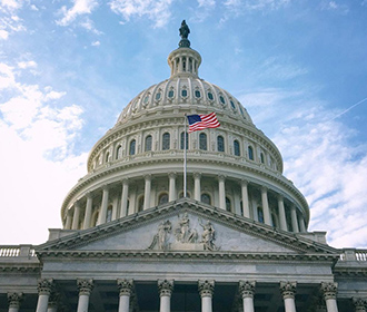 United States Capitol with American Flag
