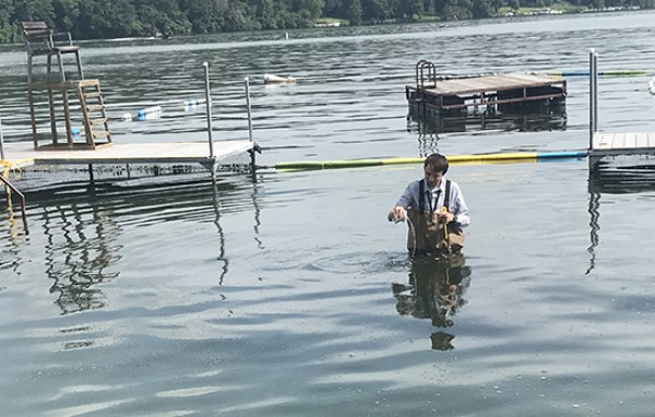 Intern collecting water samples for verify potential for Harmful Algal Blooms